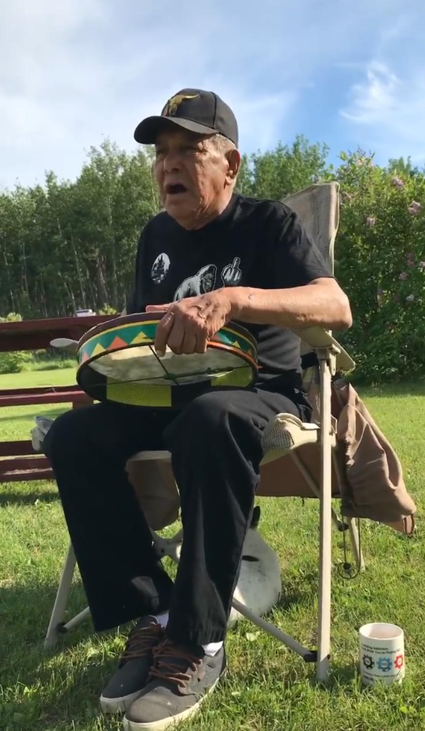 Native-elder-singing
